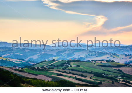 A scenic view with blue skies over the beautiful hills in Le Marche, Italy. - Stock Photo