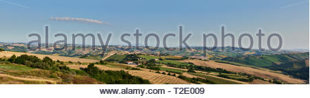 A beautiful panoramic view with blue skies over the hills of Le Marche, Italy - Stock Photo