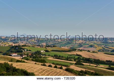 A beautiful view with blue skies over the hills of Le Marche, Italy - Stock Photo