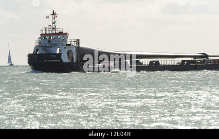 MTB Blade Runner Two deck cargo ship carrying a blade from a wind turbine from its Isle of Wight Factory across the Solent towards Southampton. - Stock Photo