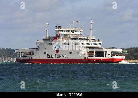 Red Eagle Isle of Wight car ferry from Cowes to Southampton run by Red Funnel journeys towards Southampton up the solent estuary on a sunny day. - Stock Photo