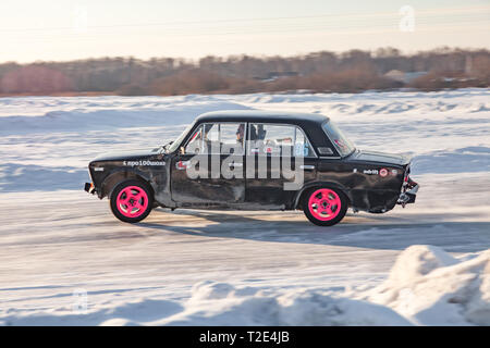 Novosibirsk, Russia - 02.02.2019: Old Russian cars Lada 2101 and 2104 prepared for racing drive on the ice on a frozen lake, drifting and moving in a  - Stock Photo