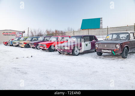 Novosibirsk, Russia - 02.02.2019: Old Russian cars Lada 2101 and 2104 prepared for racing standing on parking and waiting for  drifting and moving in  - Stock Photo