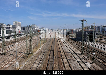 View towards main station in Munich with trails and power supply lines and graffiti in foreground - Stock Photo
