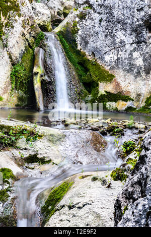 Small mountain creek waterfall cascading down the rocks in the village Ostrovica, Nature park 'Sicevo gorge', Serbia.