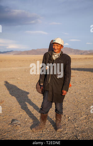 bayan Ulgii, Mongolia, 3rd October 2015: nomad man with his musical instrument in a landscape of Mongolia - Stock Photo