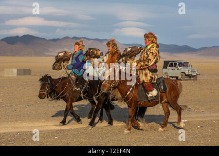 bayan Ulgii, Mongolia, 3rd October 2015: kazakh eagle hunters in a landscape of Mongolia - Stock Photo