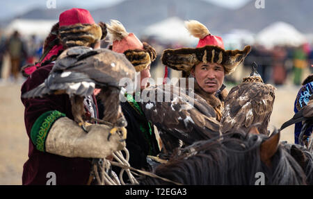 bayan Ulgii, Mongolia, 3rd October 2015: eagle hunters chatting - Stock Photo