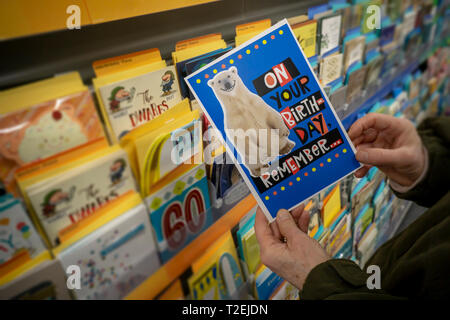 A Shopper Chooses Birthday Card From Display In Store New York On