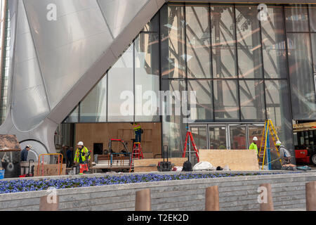 Workers scurry about preparing 'The Shed' arts space in Hudson Yards for its opening, seen on Saturday, March 30, 2019 . (© Richard B. Levine) - Stock Photo