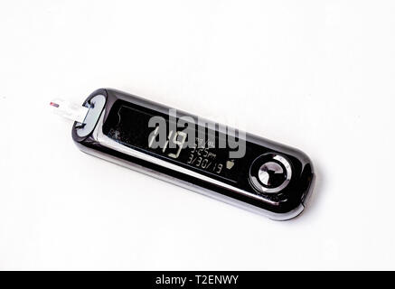 A Contour Next blood glucose meter indicates a high blood sugar reading of 119 before a meal, March 30, 2019. - Stock Photo