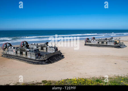 190330-N-NB544-1071 PACIFIC OCEAN (March 30, 2019) Landing craft air cushion (LCAC) 58, front, assigned to Assault Craft Unit (ACU) 5,  prepares to depart as LCAC 57 prepares to unload vehicles and Marines assigned to the 11th Marine Expeditionary Unit (MEU). John P. Murtha is underway conducting routine operations as a part of USS Boxer Amphibious Ready Group (ARG) in the eastern Pacific Ocean. (U.S. Navy photo by Mass Communication Specialist 2nd Class Kyle Carlstrom) - Stock Photo