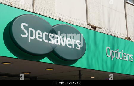 Specsaver signage above the entrance of the outlet in Broad Street, Reading, UK - Stock Photo