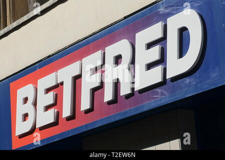 Betfred sign above the entrance of the betting shop in Reading, UK - Stock Photo