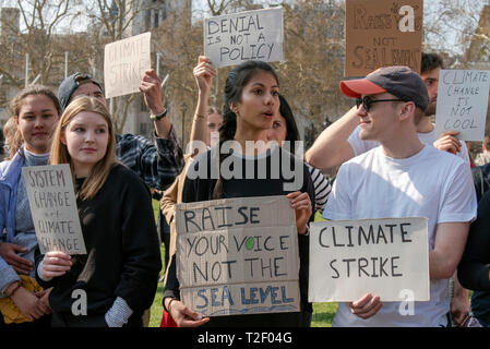 Student climate change protestors at Parliament Square in London. - Stock Photo