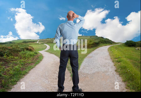 man at fork in the road concept image - Stock Photo