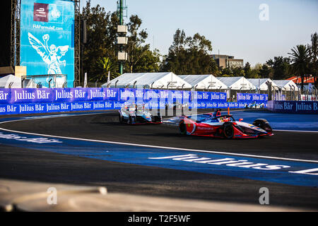 Mexico City, Mexico - February 16, 2019: Autodromo Hermanos Rodriguez. Mexico City E-Prix. Mahindra Racing driver Pascal Wehrlein at the No. 94, Nissan e.dams Team drivers Oliver Rowland at the No.22 , and Sebastien Buemi at the No. 23, Audi Sport ABT Schaeffler driver Lucas di Grassi at the No. 11, and BMW i Andretti Motorsport driver Antonio Felix da Costa at the No. 28, running at Mexico City E-Prix. - Stock Photo