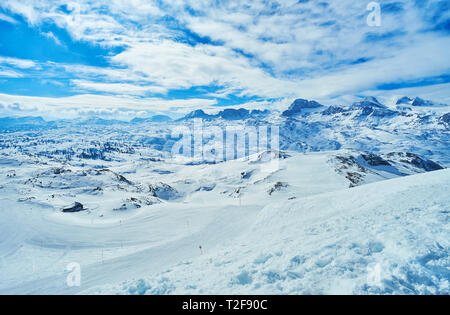Breathtaking Alpine landscape of Dachstein massif from the snowy slope of Krippenstein mount, covered with numerous ski runs, Salzkammergut, Austria. - Stock Photo