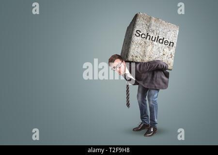 Concept of a businessman bending under the burden of heavy debts. Translation on stone: debts - Stock Photo