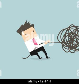 Businessman trying to unravel tangled rope or cable. - Stock Photo