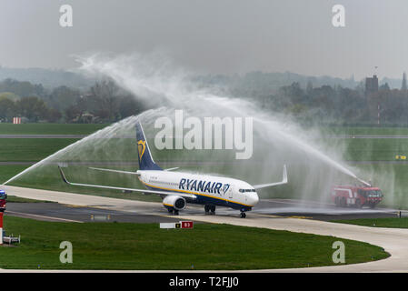Ryanair have launched their first services from London Southend Airport with the first scheduled passenger service arrival (from Dublin) greeted by a water arch salute from fire engines - Stock Photo
