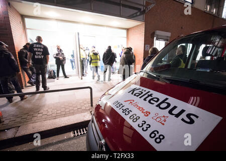Hamburg, Germany. 12th Feb, 2019. Volunteers from the Kältebus team take two homeless people to their emergency winter shelter in Friesenstraße. The cold bus for people living on the streets was made possible by the Hamburg aid project Alimaus and in the winter months was provided by more than 40 volunteers. (to dpa: '180 trips for the homeless - Hamburger Kältebus draws a positive balance' from 03.04.2019). Credit: Christian Charisius/dpa/Alamy Live News - Stock Photo