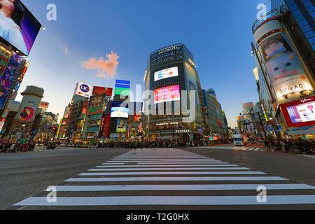 Shibuya pedestrian crossing in Shibuya with lights at night, Tokyo, Japan - Stock Photo