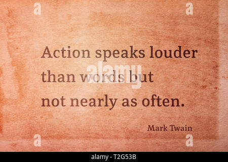 Action speaks louder than words but not nearly as often - famous American writer Mark Twain quote printed on vintage grunge paper - Stock Photo