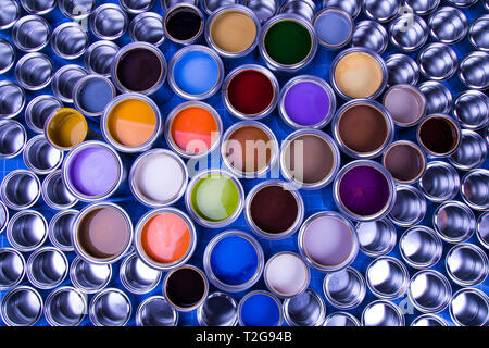 Concept group of tin metal cans with color paint - Stock Photo
