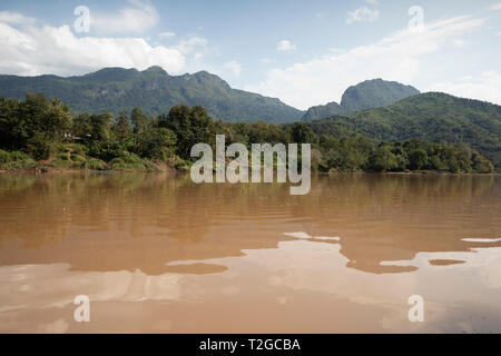 Karsk peaks viewed from boat along the Nam Ou River, Nong Khiaw, Muang Ngoi District, Luang Prabang Province, Northern Laos, Laos, Southeast Asia - Stock Photo