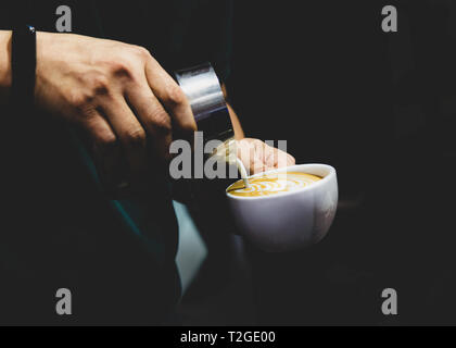 Barista working in a coffee shop, Close up of barista presses ground coffee using tamper, Barista Make Coffee Portafilter Concept - Stock Photo