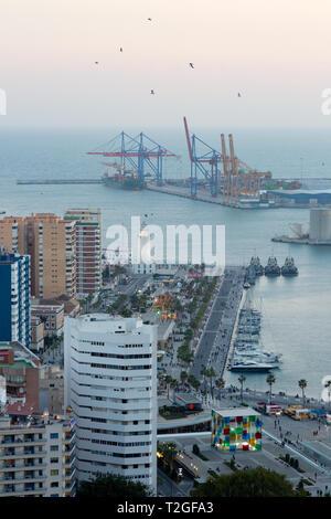Malaga Docks - Evening view towards the docks and La Farola lighthouse, Malaga, Andalusia Spain - Stock Photo