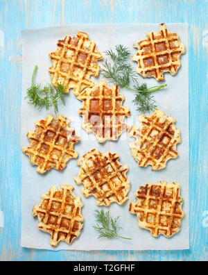 healthy breakfast. savory  spinach dill waffles on a blue background. view from above - Stock Photo