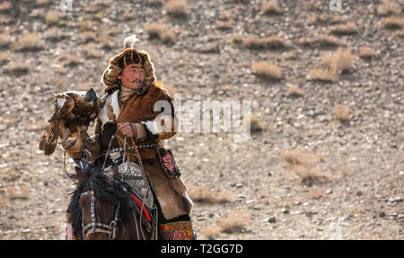 bayan Ulgii, Mongolia, 4th October 2015: kazakh eagle hunter on his horse - Stock Photo
