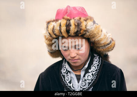 bayan Ulgii, Mongolia, 3rd October 2015: young kazakh eagle hunter - Stock Photo