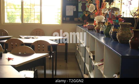 Decorated Painted Pots on shelf in Art Classroom - Stock Photo