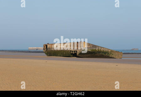 Arromanches-les-Bains,Normandy, France, March,27, 2019, Remains of the Mulberry Harbour build by the  allies in June 1944 as seen on the beach today - Stock Photo