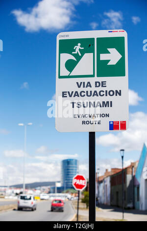 A tsunami evacuation route sign in Punta Arenas, Chile. - Stock Photo