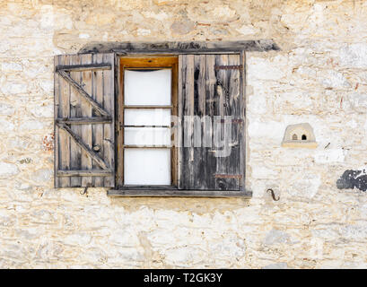 Window of a wooden hut - Stock Photo