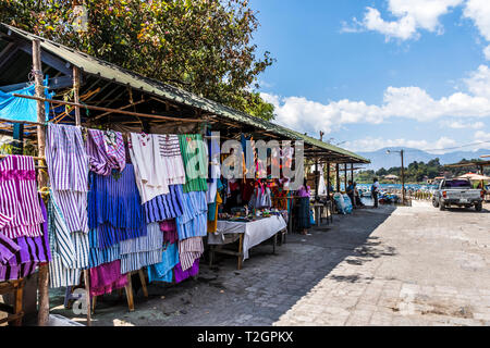Santiago Atitlan, Lake Atitlan, Guatemala - March 8, 2019: Stall selling Mayan textiles & souvenirs in largest Mayan town on Lake Atitlan in Guatemala - Stock Photo