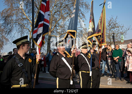 Musselburgh True Defenders Flute Band from Northern Ireland play as thousands of Leave supporters gathered in Parliament Square to protest against the delay to Brexit, on the day the UK had been due to leave the EU on 29th March 2019 in London, United Kingdom. As parliament debated and voted inside the commons, rejecting the Withdrawal Agreement again, outside in Westminster various groups of demonstrators including the Yellow Jackets, Leave Means Leave supporters and the Democratic Football Lads Alliance, gathered to voice their wish to leave the European Union, and their frustration that Bre - Stock Photo