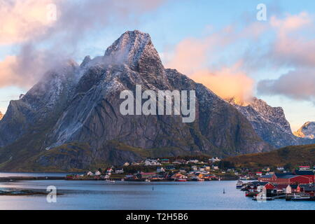 Olstinden mountain above town at sunset in Reine, Moskenes, Norway, Europe - Stock Photo