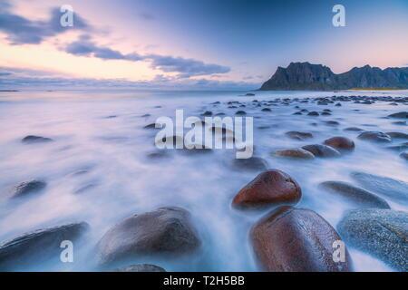Long exposure shot of rocks on Uttakleiv beach in Vestvagoy, Norway, Europe - Stock Photo