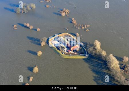Farm at Heisterbusch surrounded by the Elbe flood, aerial view, Bleckede, Lower Saxony, Germany - Stock Photo
