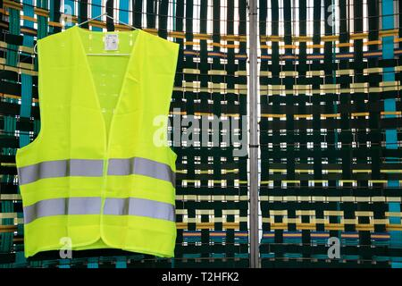 Yellow vest exhibited at the biennale of design. Saint Etienne, Loire, Auvergne Rhone Alpes. Saint-Etienne, FRANCE - 04/01/2019     Gilet jaune expose - Stock Photo