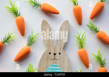 Wooden Easter Bunny With Orange Carrots Stock Photo 242560250 Alamy