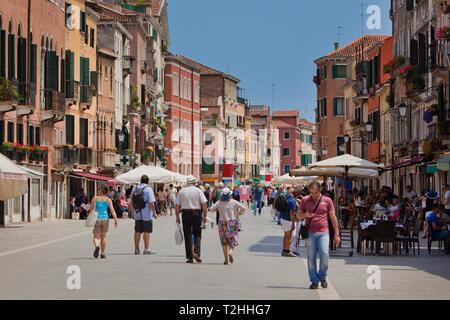 People walking along Via Garibaldi in Venice, Veneto, Italy, Europe