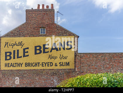 The famous pre-1940 Bile Beans advertisement  in York.  The painted sign is on the side of a brick building and there is a blue sky above. - Stock Photo