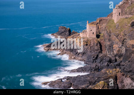 Disused tin mine buildings on dramatic cliff edges of north Atlantic coast, Botallack, Cornwall, England, UK - Stock Photo