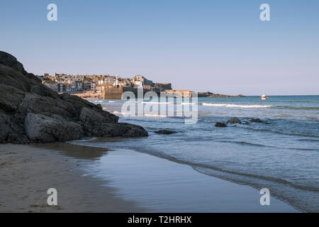 St Ives harbour on a bright sunny March day, viewed from Porthminster Beach, Cornwall, England, UK - Stock Photo